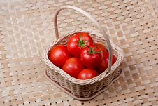 Free Tomato Basket With Bamboo Mat Background Royalty Free Stock Image - 8979466