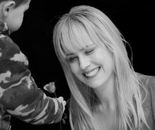 Free Little Boy Handing Flower To A Beautiful Woman Stock Photo - 8980940