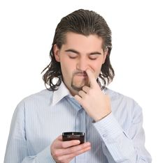 Free Young Guy Picks Nose And Holds Cell Phone Isolated Stock Images - 8981054