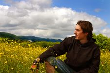 Young Man On Yellow Meadow In Sunny Weather Royalty Free Stock Photography