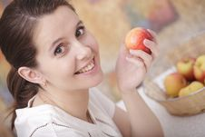 Girl With An Apple Stock Images