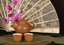 Chinese Teapot And Antique Fan Horizontal Stock Photo
