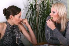 Women Gossiping And Eating Stock Images