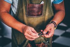Free Man In Brown Leather Overalls Holding Black Tool Royalty Free Stock Photos - 89806508