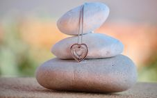 Free Meditation Stones And Heart Pendant Stock Image - 89807281
