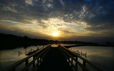 Free Pontoon Over Lake At Sunset Royalty Free Stock Images - 89892679