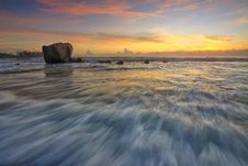 Free Waves On Beach With Rock At Sunset Royalty Free Stock Photo - 89892755