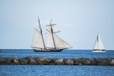 Free Sailboats Behind Rocky Causeway Royalty Free Stock Image - 89893226