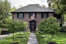Brick Home With American Flag Royalty Free Stock Photography