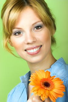 Free Smiling Woman With A Flower Royalty Free Stock Photo - 8991185