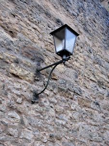 Forged Street Lamp On The Wall Stock Photography