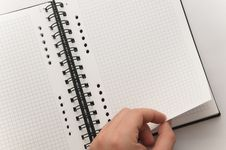 Free Hand Turning Page Of Notebook Stock Photo - 8991380