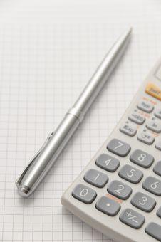 Free Elegant Silver Pen And Scientific Calculator Stock Photos - 8991563