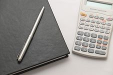Free Scientific Calculator Next To Notebook Stock Photo - 8991570