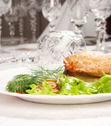 Backed Meat And Green Salad With Goblets Royalty Free Stock Photo