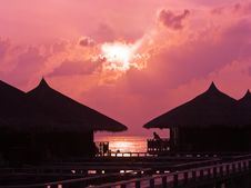 Free Human Silhouette In Water Bungalow At Sunset Royalty Free Stock Photography - 8997137