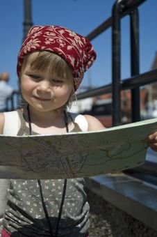 Little Girl With A City Map. Travel Royalty Free Stock Image