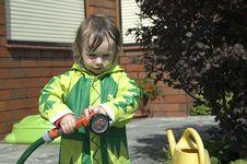 Girl Watering The Garden Royalty Free Stock Photos