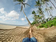 Free Relaxing On A Brown Knitted Hammock Royalty Free Stock Photo - 89961955