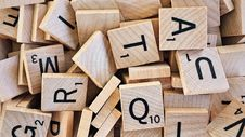Free Scrabble Tiles With Letters Royalty Free Stock Photos - 89963168