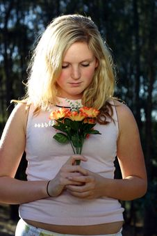 Free Woman Holding Flowers Royalty Free Stock Image - 91106