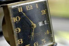 Dusty Old Travel Clock Stock Photography
