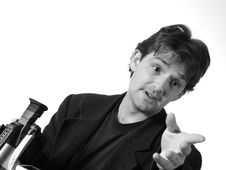Free Man With Camera Gesturing Stock Photography - 901722