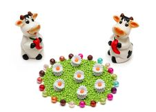 Free Two Ceramic Cows And A Flower Meadow From Beads Royalty Free Stock Photography - 9002617