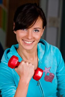 Funny Woman Curls Dumbbells Stock Photography
