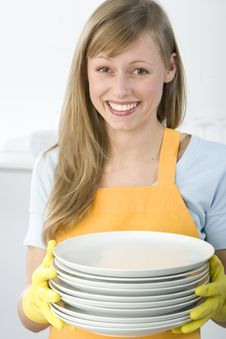 Woman Cleaning Dishes Stock Image