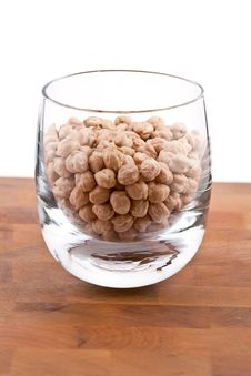 Free Chickpeas In Glass On Wooden Table Stock Photos - 9009773
