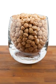 Free Chickpeas In Glass On Wooden Table Stock Photography - 9009782