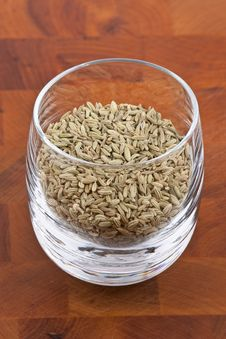 Dried Fennel Seeds In Glass Royalty Free Stock Image