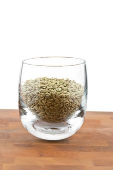Dried Fennel Seeds In Glass On Wooden Table Royalty Free Stock Images