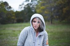 Free Woman Wearing Gray Hoodie Over Green Grass Selective Focus Photography Stock Image - 90033631