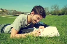 Free Young Man In Field Writing Royalty Free Stock Photo - 90036255
