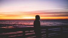 Free Man By Fence Overlooking Sea Royalty Free Stock Image - 90037636