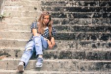 Free Woman Sitting On Stairs Royalty Free Stock Images - 90097239