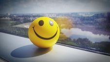 Free Yellow Smiley Ball Near Clear Glass Window Panel Royalty Free Stock Image - 90097366