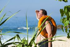 Free Man Relaxing On Tropical Beach Royalty Free Stock Photo - 90098235