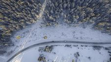 Free Aerial View Over Snowy Road Royalty Free Stock Photos - 90098338