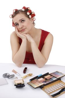Woman With Hair-rollers Thinks About Something. Stock Photography