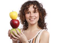 Girl With Apples. Stock Photo