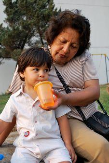 Free Grandmother Feeding Her Grandson Water Royalty Free Stock Photos - 9013428