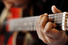 Hand Playing Guitar Stock Photography