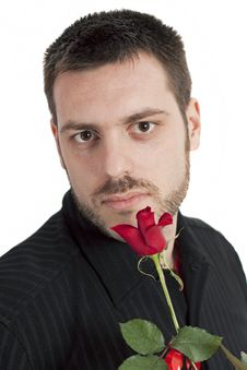 Young Man Holding Red Rose Royalty Free Stock Photo