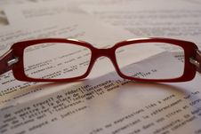 Free Red Framed Eyeglass On Top Of Paper Royalty Free Stock Photography - 90154457