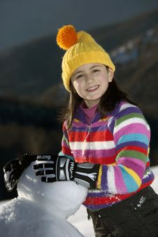 Free Young Girl Posing With Her Snowman Stock Photos - 9020903