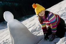 Free Young Girl Posing With Her Snowman Royalty Free Stock Photo - 9021255