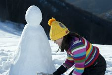 Free Young Girl Posing With Her Snowman Royalty Free Stock Photography - 9021307